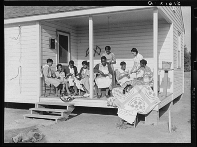 Home economics and home management class for adults, under supervision of Miss Evelyn M. Driver (standing in white uniform). Everything they make including the small handmade looms, utilizes materials of local origin as cornshucks, cane, flour and meal and feed sacks, etc. Flint River Farms, Georgia