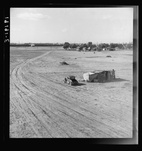 Home of Mexican family. Migratory workers. Across the road from the Farm Security Administration (FSA) migratory labor camp (emergency). Calipatria, Imperial Valley, California