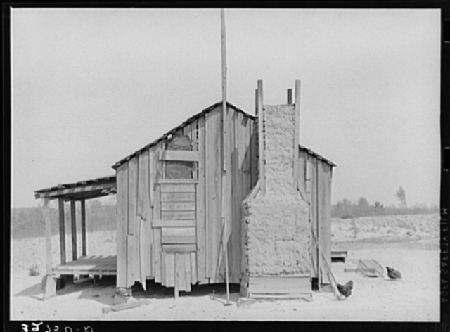 Home of tenant farmer with mud and straw chimney. Near Marshall, Texas