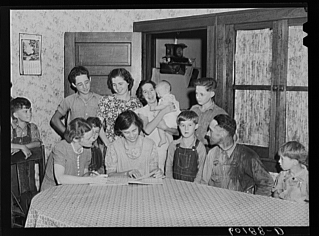 Home supervisor (FSA (Farm Security Administration)) visiting family of rehabilitation client. Grant County, Wisconsin