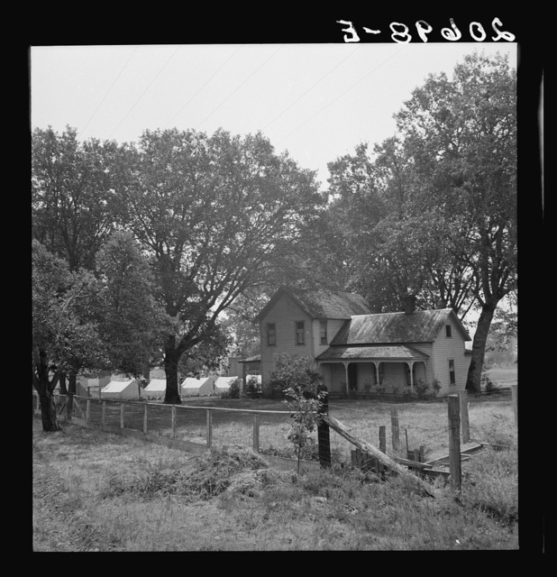 Hop grower's home on Rogue River, with the tent camp he provides for his pickers beyond. Oregon, Josephine County, near Grants Pass. See general caption number 45-11