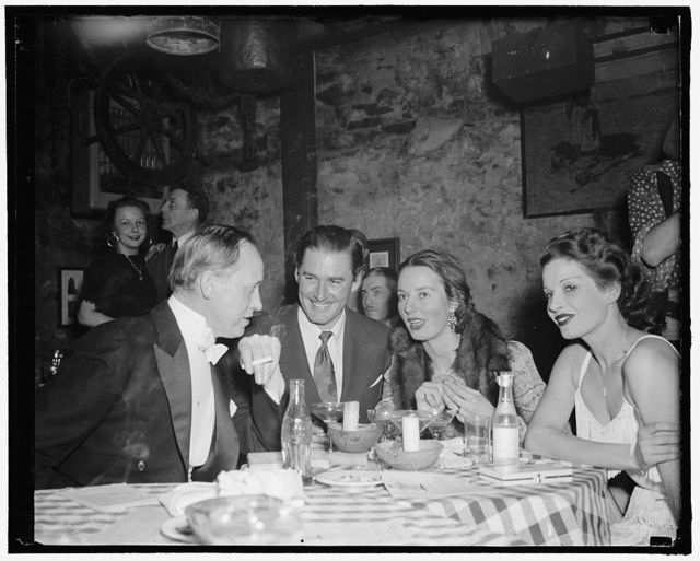 Hopkins and Stars see club opening. Washington, D.C., Feb. 8. Washington's newest supper club opened last night with celebrities and stars in attendance. Here, Hopkins, Secretary of Commerce, movie star Errol Flynn and Mrs. John Hay Whitney, wealthy socialite, found their way to fun. Note the 'pop' bottle on the table, 2-8- 39