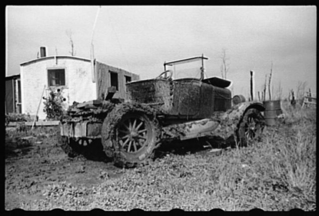 House and automobile belonging to farmer of cut-over area, Lake of the Woods County, Minnesota