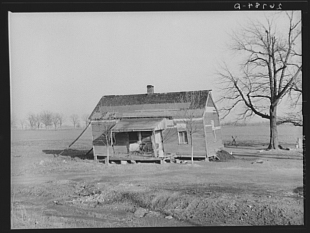House damaged by flood. Saline County, Illinois