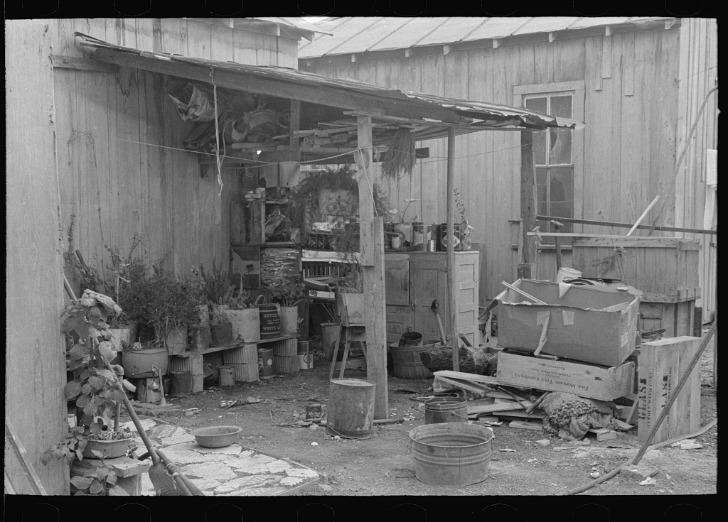 Household goods in backyard of Mexican house, San Antonio, Texas