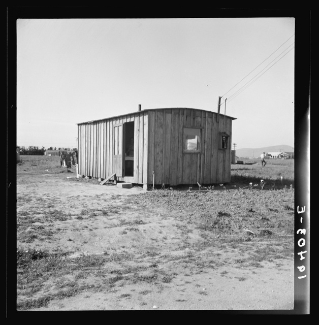 Housing for rapidly growing settlement of lettuce workers on fringe of town, Salinas, California. These houses are built by the occupants, most of them recent migrants from the Southwest