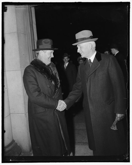 Hull welcomes Brazilian Foreign Minister. Washington, D.C., Feb. 9. Foreign Minister Oswaldo Aranha of Brazil is welcomed by Secretary of State Cordell Hull on his arrival at Union Station today. Minister Aranha is in the Capitol to discuss defense and trade with President Roosevelt and other U.S. officials, 2-9- 39