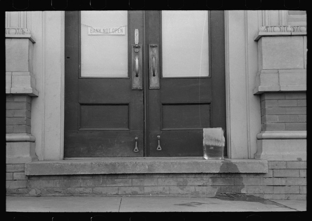 Ice melting on doorstep before bank opens, San Augustine, Texas