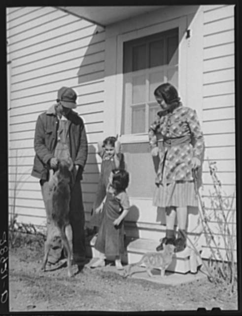 In addition to the cooperative profits and wages he receives, Jerry Vardiman has a good house. Osage Farms, Missouri