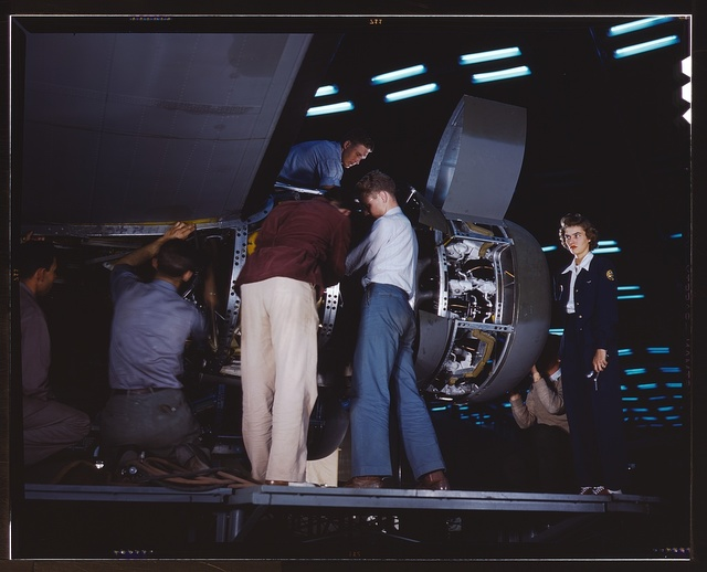 Installing an engine at the Consolidated Aircraft Corporation plant, Fort Worth, Texas