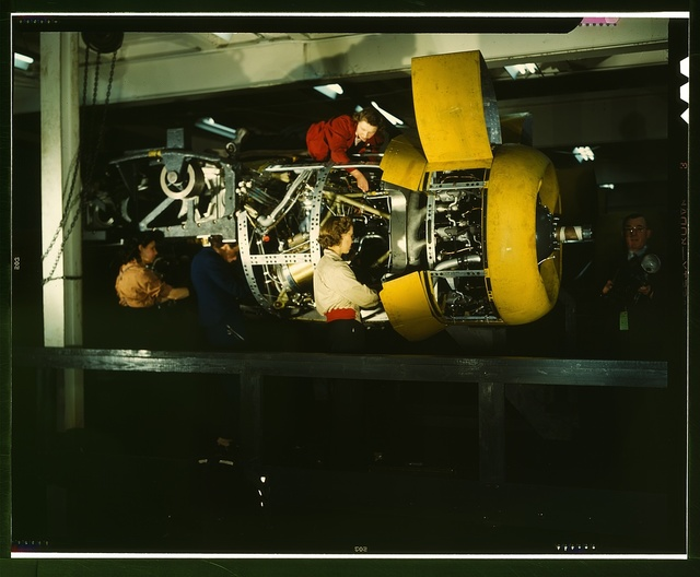 Installing one of the 4 motors on the transport plane at Willow Run