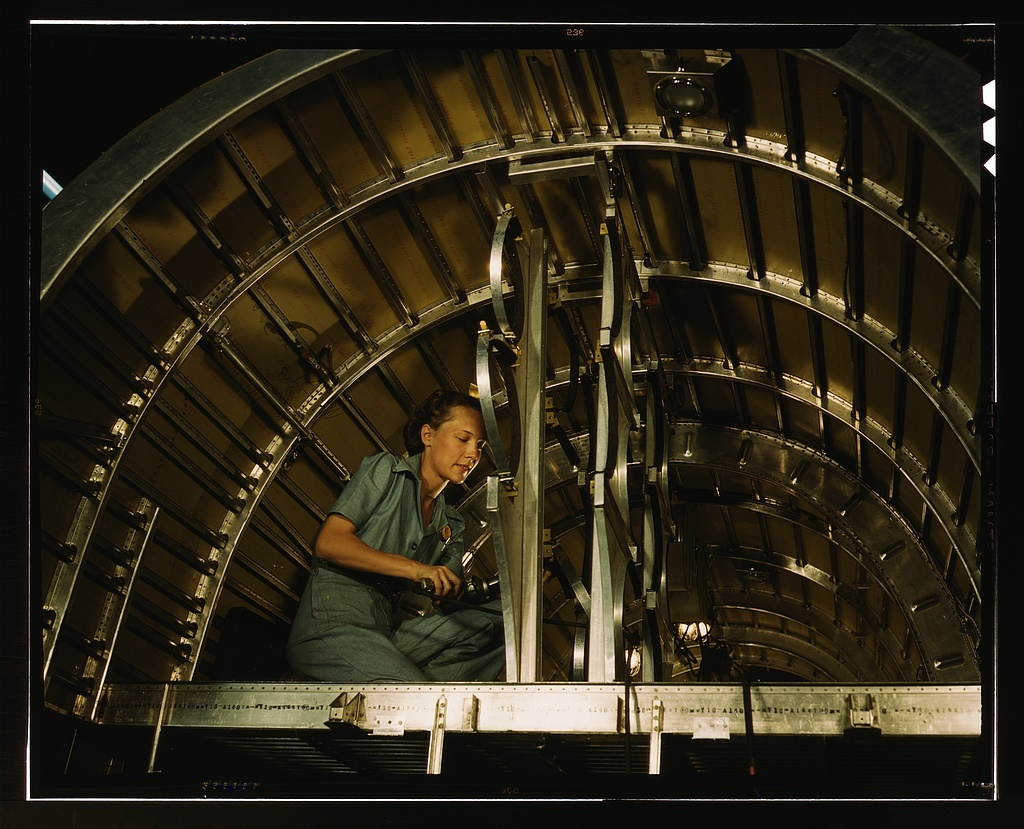 Installing oxygen flask racks above the flight deck of a C-87 transport at the Consolidated Aircraft Corporation plant, Fort Worth, Texas