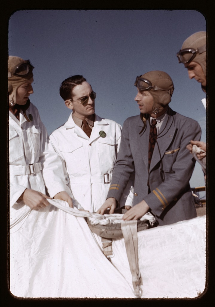 Instructor explaining the operation of a parachute to student pilots, Meacham Field, Fort Worth, Tex.