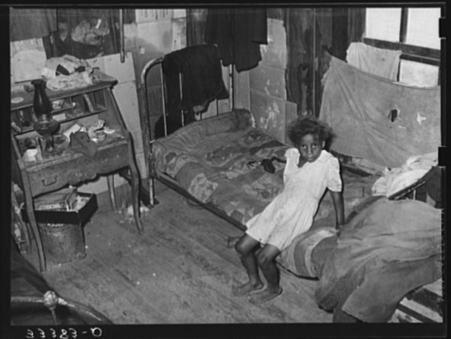 Interior of Negro agricultural day laborer's home in Muskogee County, Oklahoma. These houses rent from two to five dollars per month