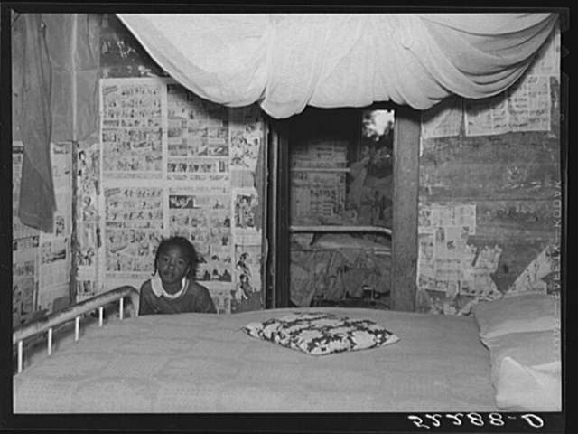 Interior of Negro tenant's home showing mosquito netting over bed. Mileston Plantation, Mississippi Delta, Mississippi