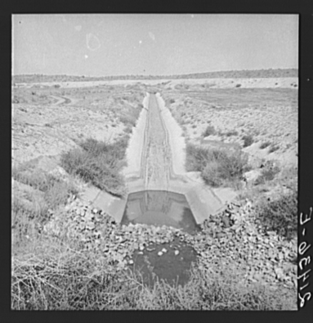 Irrigation canal. Shows drop to go under road. Water has just been shut off for the season. Near Nyssa, Malheur County, Oregon