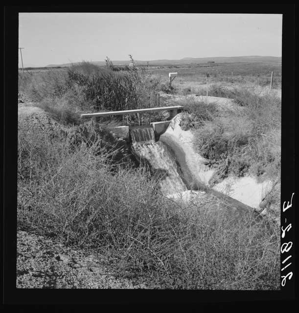 Irrigation ditch, showing drop in canal. Dead Ox Flat, Malheur County, Oregon. General caption number 67-1