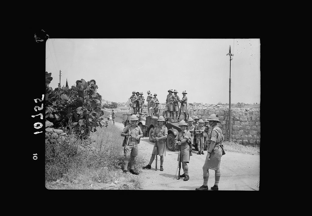 Jewish anti Palestine White Paper demonstrations. [Women's demonstration on May 22, 1939]. British troops in reserve behind cactus hedge close to King George Ave.