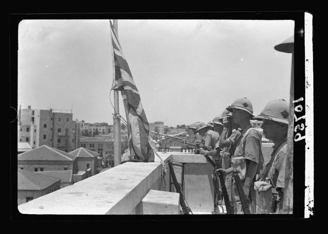 Jewish anti Palestine White Paper demonstrations. [Women's demonstration on May 22, 1939]. Troops on roof of District Commissioner's offices [Jerusalem]