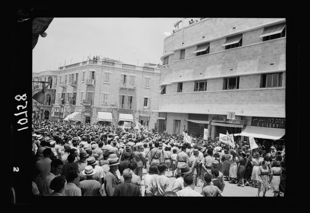 Jewish anti Palestine White Paper demonstrations. [Women's demonstration on May 22, 1939]. Demonstration before the District Offices on the Jaffa Road, taken while one of the young women was emphatically denouncing the new polity