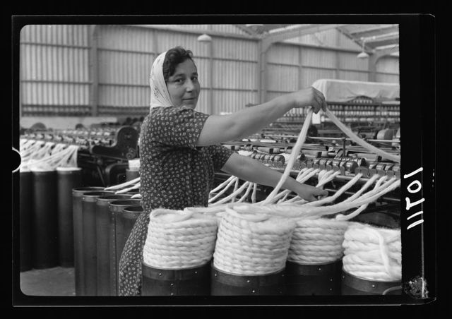 "Jewish factories in Palestine on Plain of Sharon & along the coast to Haifa. Near Acre, Kfar-Ata. The ""Ata"" Textile Co. Doubling of primary yarn, close up (first process)"