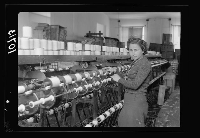 "Jewish factories in Palestine on Plain of Sharon & along the coast to Haifa. Near Acre, Kfar-Ata. The ""Ata"" Textile Co. Third process in the spinning of the yarn"