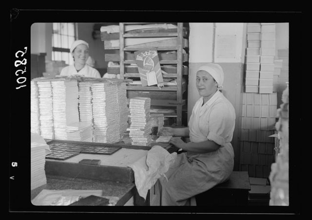 """Jewish factories in Palestine on Plain of Sharon & along the coast to Haifa. Ramath Gan. The """"Elite"""" Chocolate Factory. Aluminum foil used for chocolate wrappings"""