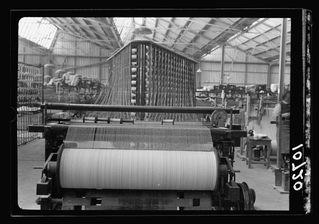 "Jewish factories in Palestine on Plain of Sharon & along the coast to Haifa. Near Acre, Kfar-Ata. The ""Ata"" Textile Co. Warping machine, close up"