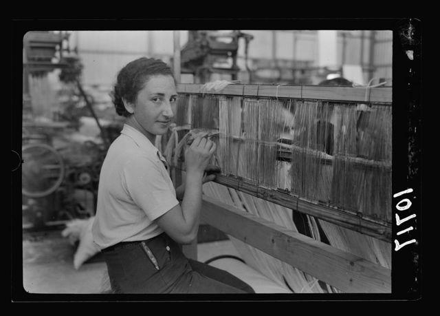 "Jewish factories in Palestine on Plain of Sharon & along the coast to Haifa. Near Acre, Kfar-Ata. The ""Ata"" Textile Co. Preparing the warp"