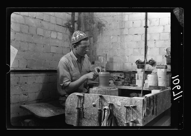 "Jewish factories in Palestine on Plain of Sharon & along the coast to Haifa. Haifa. The ""Kadar"" Ltd. Ceramics. Fashioning of a jar on the potters wheel, close up"