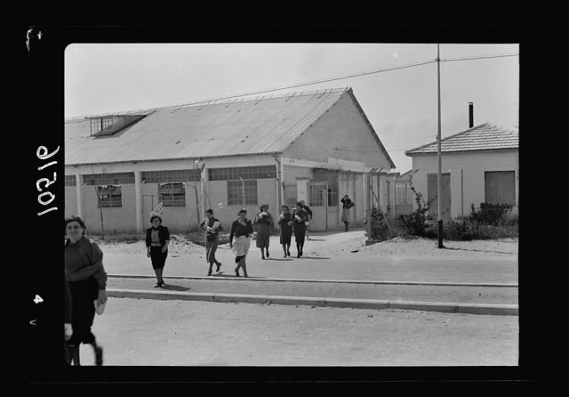 Jewish factories in Palestine on Plain of Sharon & along the coast to Haifa. The Lodzia Textile Co. in Holon settlement (meaning sandy). Factory girls leaving for lunch