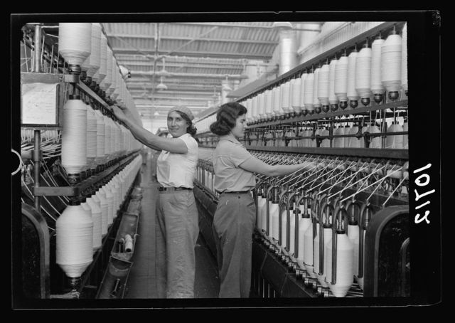 "Jewish factories in Palestine on Plain of Sharon & along the coast to Haifa. Near Acre, Kfar-Ata. The ""Ata"" Textile Co. Second process in the spinning of the yarn"