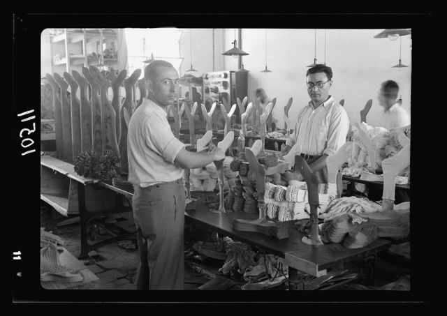 Jewish factories in Palestine on Plain of Sharon & along the coast to Haifa. The Lodzia Textile Co. in Holon settlement (meaning sandy). Electrical ironing in stocking factory
