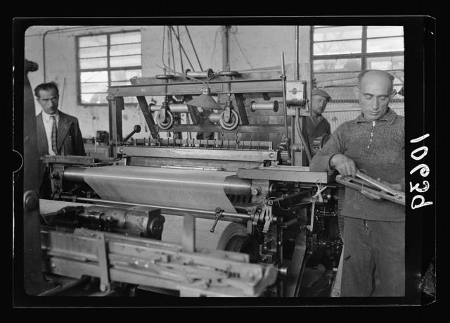 "Jewish factories in Palestine on Plain of Sharon & along the coast to Haifa. Haifa. ""Usha"" Bros., barbed wire, fencing & screening. Metal weaving loom for wire screening"