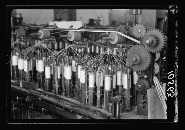 Jewish factories in Palestine on Plain of Sharon & along the coast to Haifa. Nachlat Izhak. Elastic & ribbon factory. Int[erior]. Machinery (close up)