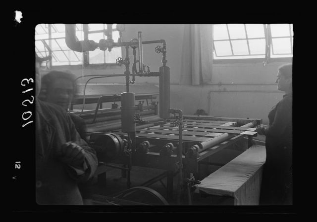 Jewish factories in Palestine on Plain of Sharon & along the coast to Haifa. The Lodzia Textile Co. in Holon settlement (meaning sandy). Electrical machine ironing