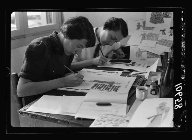 "Jewish factories in Palestine on Plain of Sharon & along the coast to Haifa. Haifa. The ""Splendid Model."" Designing & dressmaking establish[ment]. Designers at work, close up"