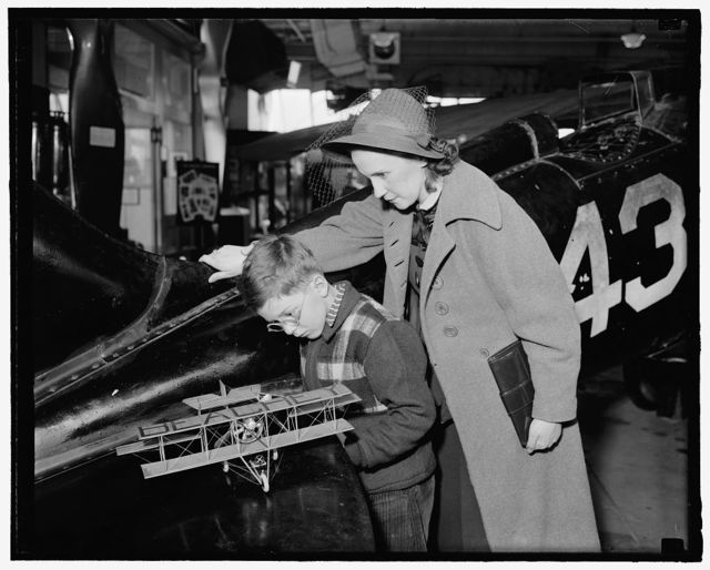 Latest addition to aircraft collection at Smithsonian Institution. Washington, D.C., April 6 -Scott Lucas and [...]Harold Butt(?), inspect the latest addition to the aircraft collection at the Smithsonian Institution, model of the small biplane which Lincoln Beachey flew over Washington twenty-five years ago to thrill the Nation's lawmakers. He gave an exhibition of air maneuvers such as never seen before to impress members of Congress with the need of Military Preparedness. 4-6-39