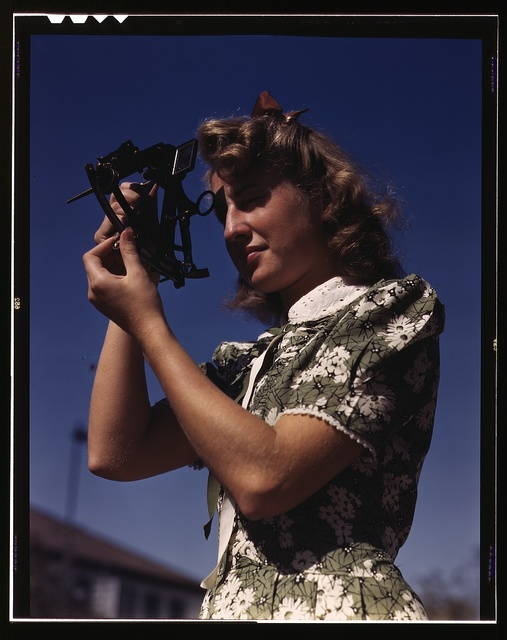 Learning how to determine latitude by using a sextant is Senta Osoling, student at Polytechnic High School, Los Angeles, Calif. Navigation classes are part of the school's program for training its students for specific contributions to the war effort