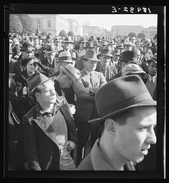 Listening to speeches at mass meeting of Works Progress Administration (WPA) workers protesting congressional cut of relief appropriations. San Francisco, California