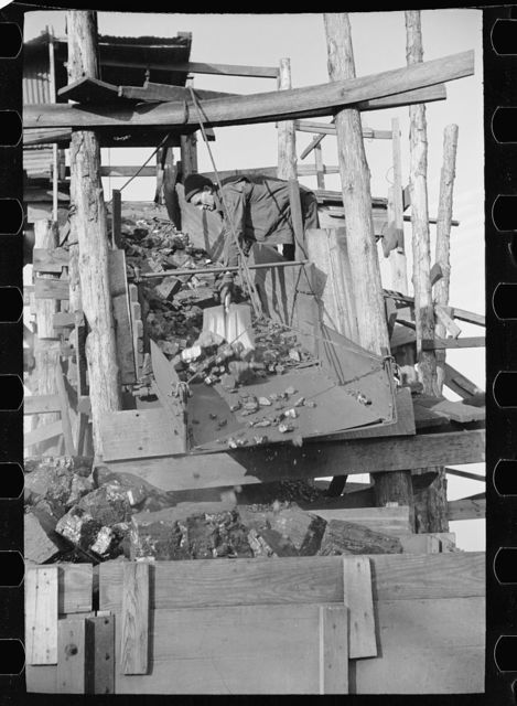 Loading a truck with run of the mine coal at gopher hole, Williamson County, Illinois