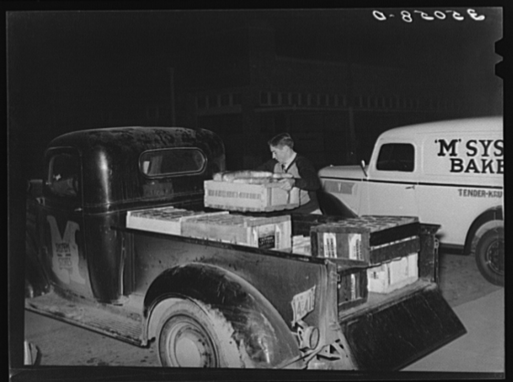 Loading bread onto truck, early morning, at the bakery. San Angelo, Texas
