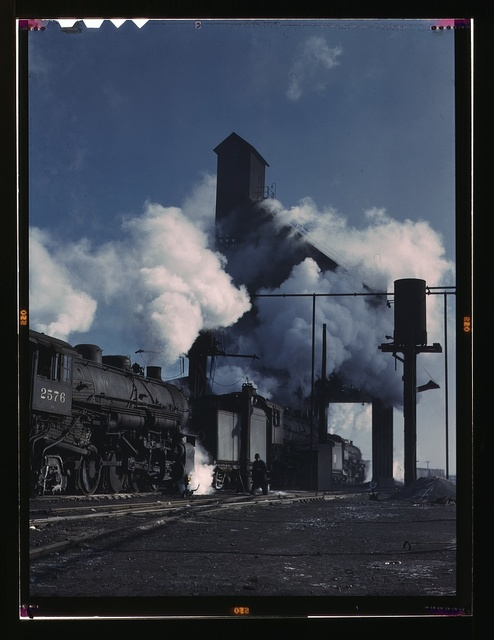 Locomotives over the ash pit at the roundhouse and coaling station at the Chicago and Northwestern Railroad yards, Chicago, Ill.