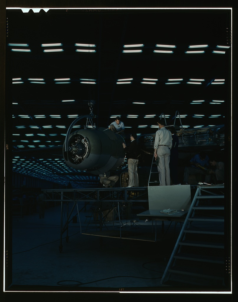 Lowering an engine in place in assembling a transport plane in a Consolidated Aircraft Corporation plant, Fort Worth, Texas