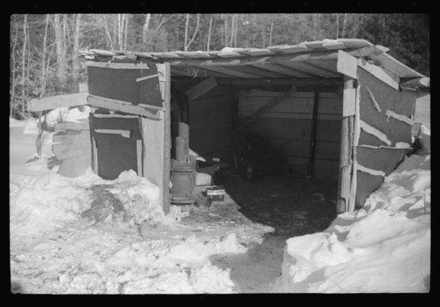 Lumbermen's shack where they can get warm, eat their lunch, and house the tractor with which they haul logs to the road where they are picked up and hauled to the mill by truck. Near Barnard, Windsor County, Vermont