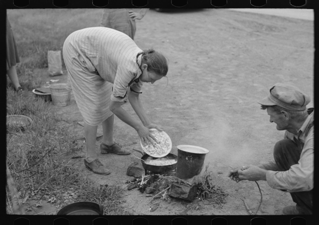 Making lunch along the roadside, near Henrietta [i.e., Henryetta,] Oklahoma. This is a migrant family en route to California
