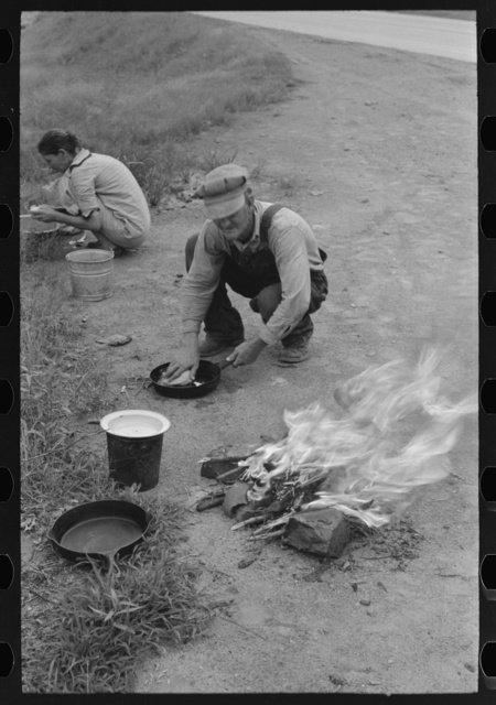 Making lunch along the roadside near Henrietta [i.e., Henryetta,] Oklahoma. This is a migrant family en route to California