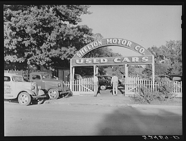 Many Negroes spend their cotton picking money on used cars. Belzoni, Mississippi