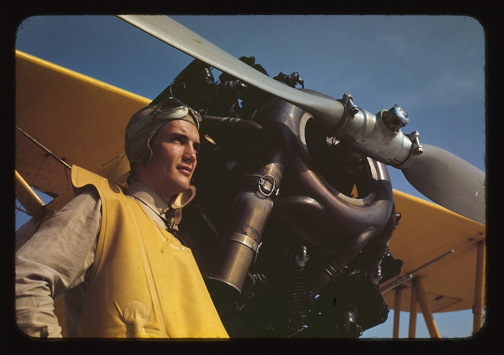 Marine lieutenant by the power plane which tows the training gliders at Page Field, Parris, Island, S.C.