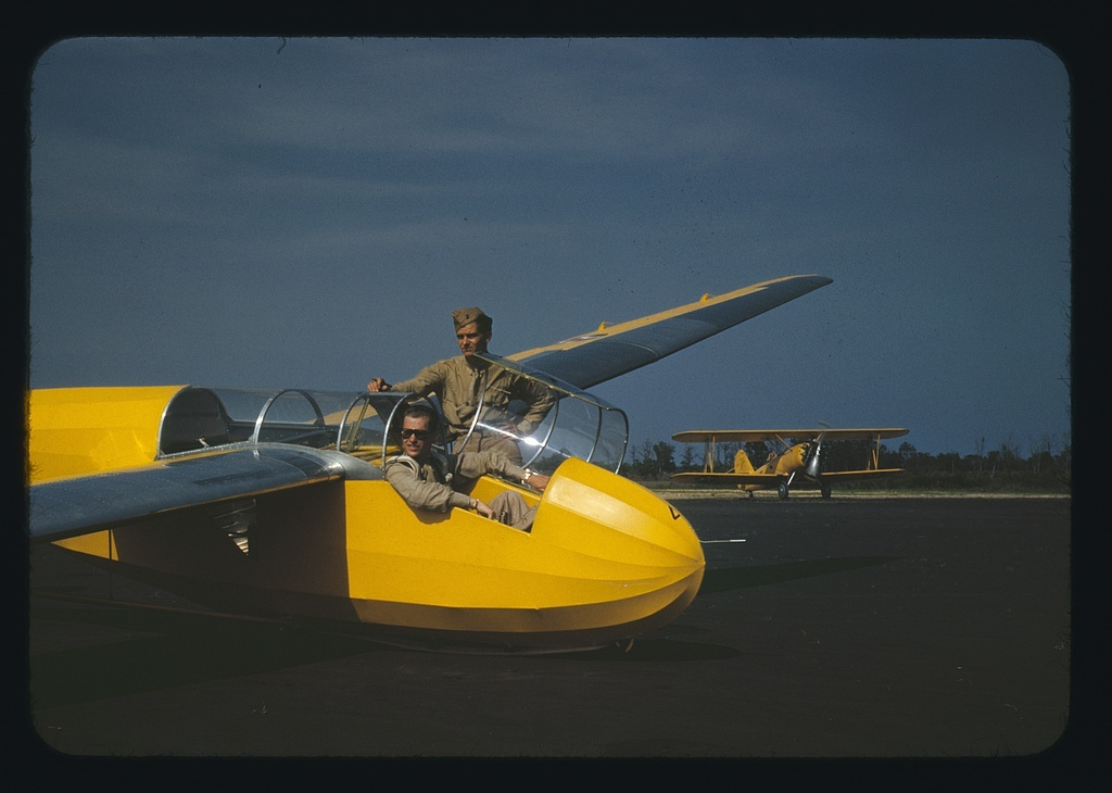 Marine lieutenant, glider pilot in training, ready for take-off at Page Field, Parris Island, S.C. Power towing plane in background